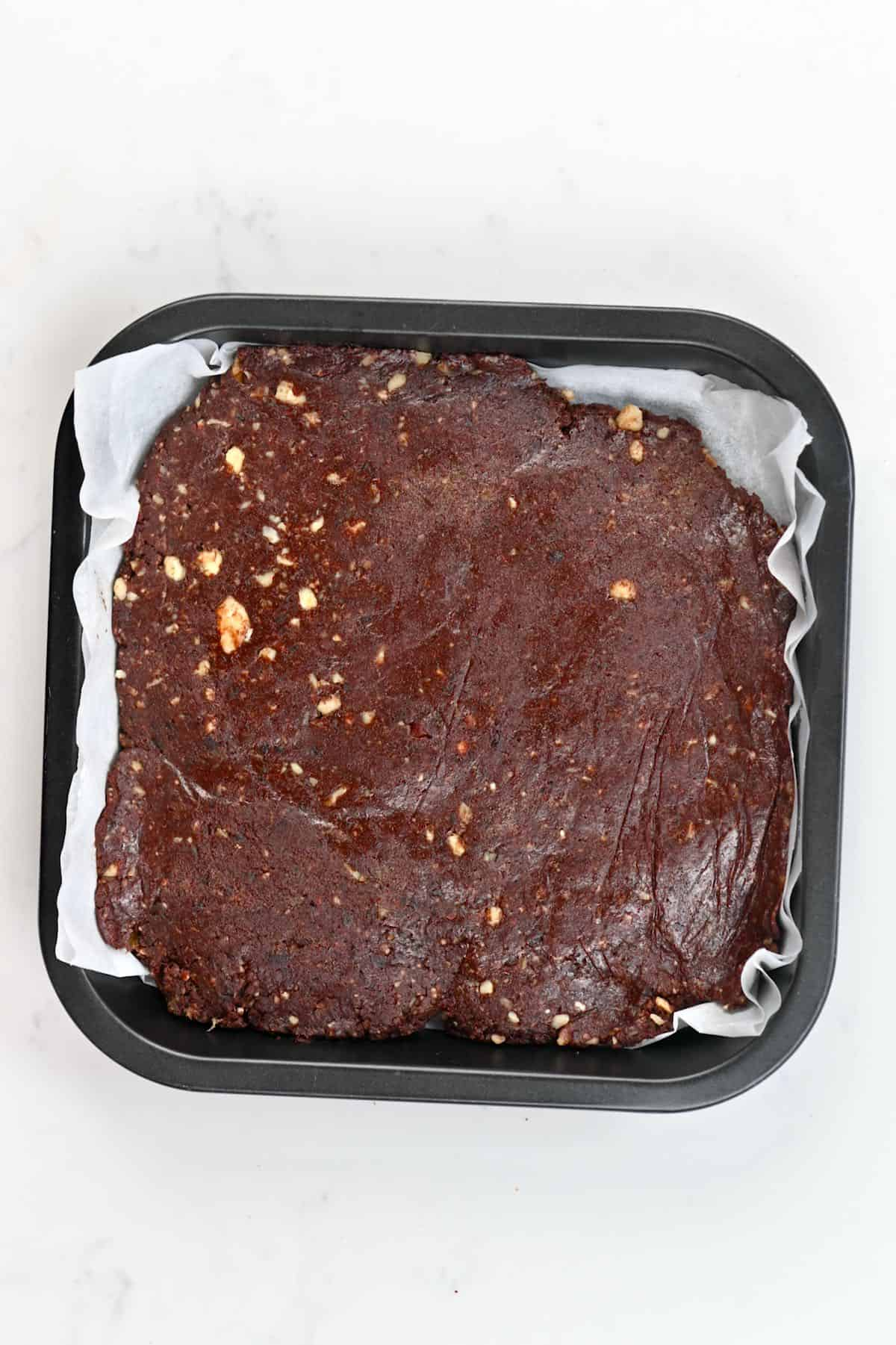No bake brownies spread in a tin