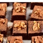 Squares of no-bake brownies with walnuts on top