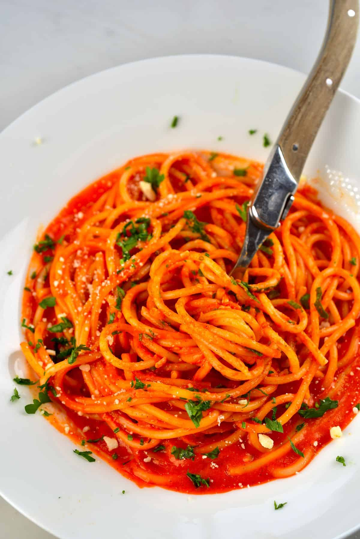 Roasted Red Pepper Sauce Pasta in a plate with a fork