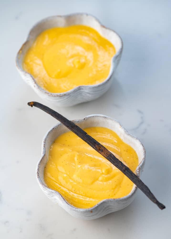 Two bowls of Vanilla custard and a vanilla pod