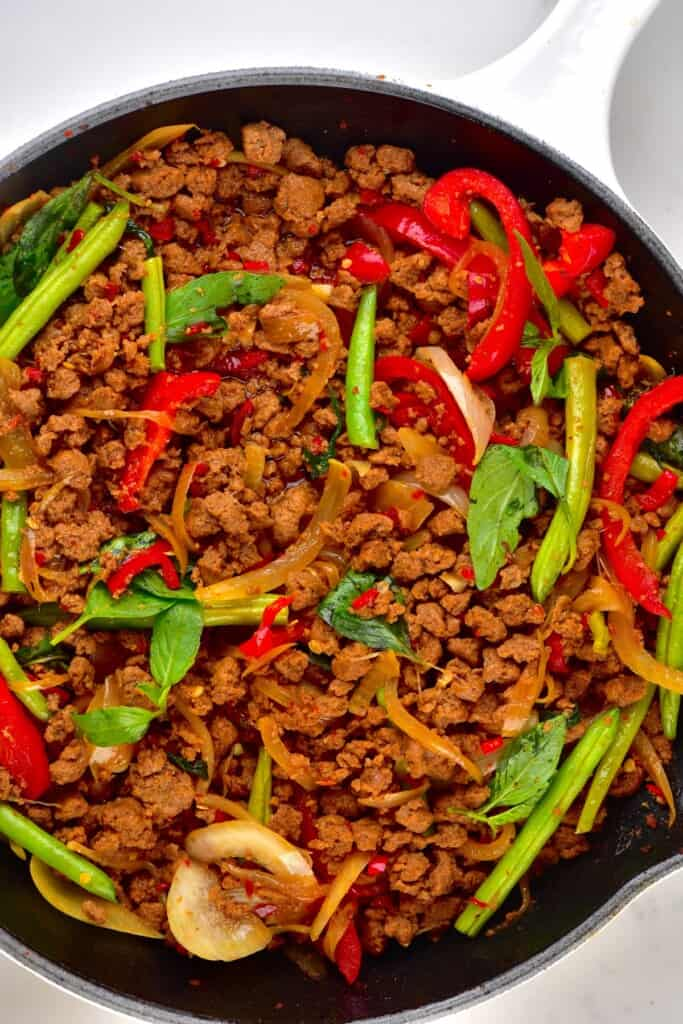 A pan with cooked Thai basil vegan beef with soy mince