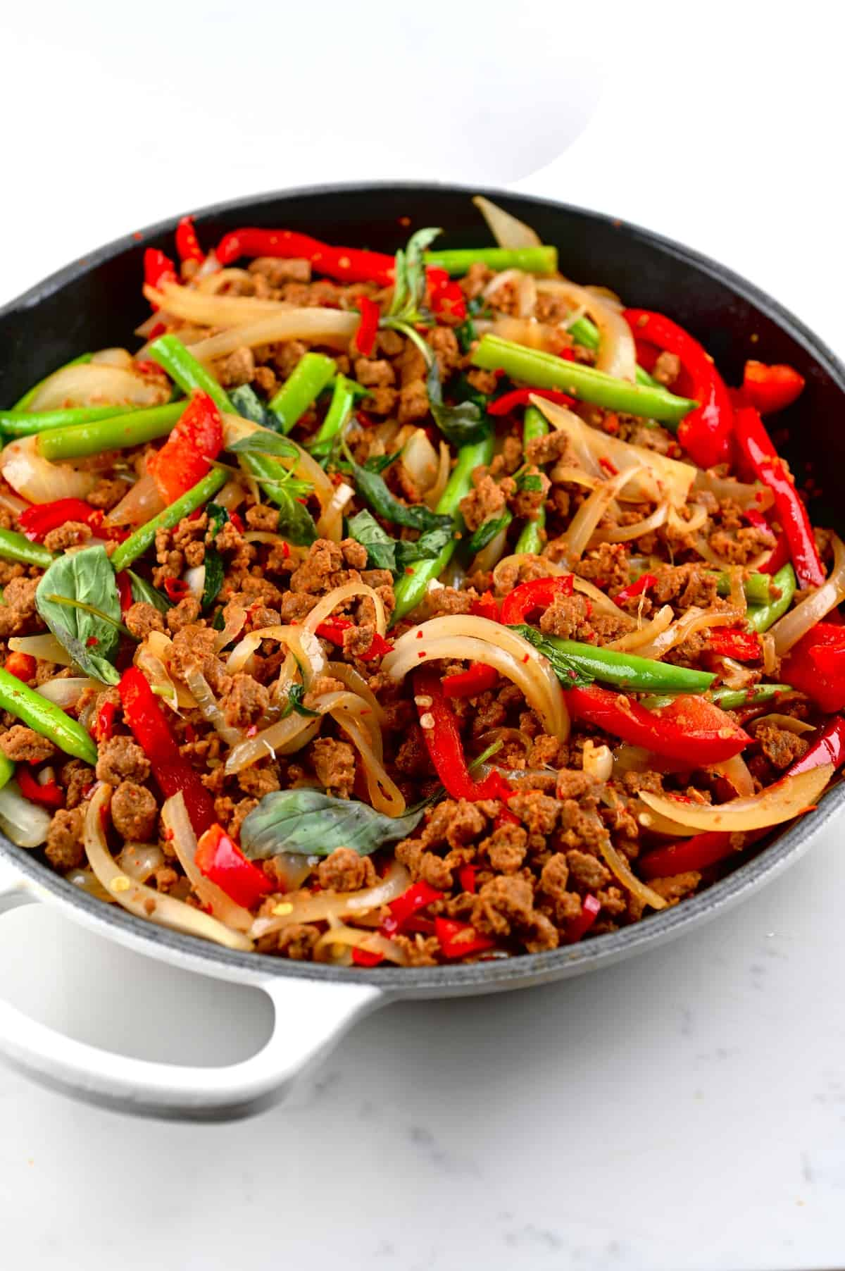 A close up of pan with cooked Thai basil vegan beef with soy mince