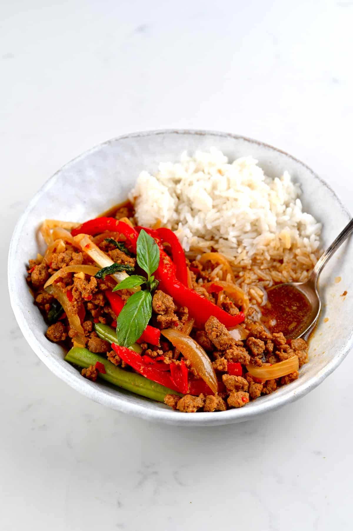 Thai basil vegan beef with soy mince and rice served in a bowl
