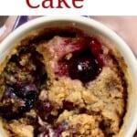 A close up of berry mug cake