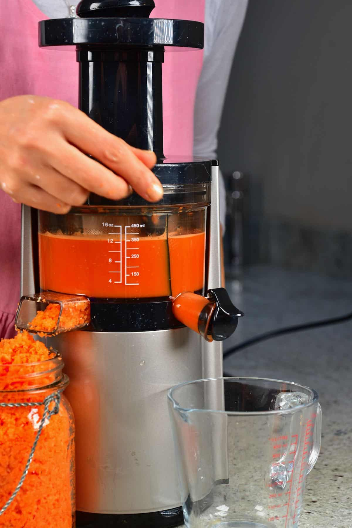 A juicer making carrot juice