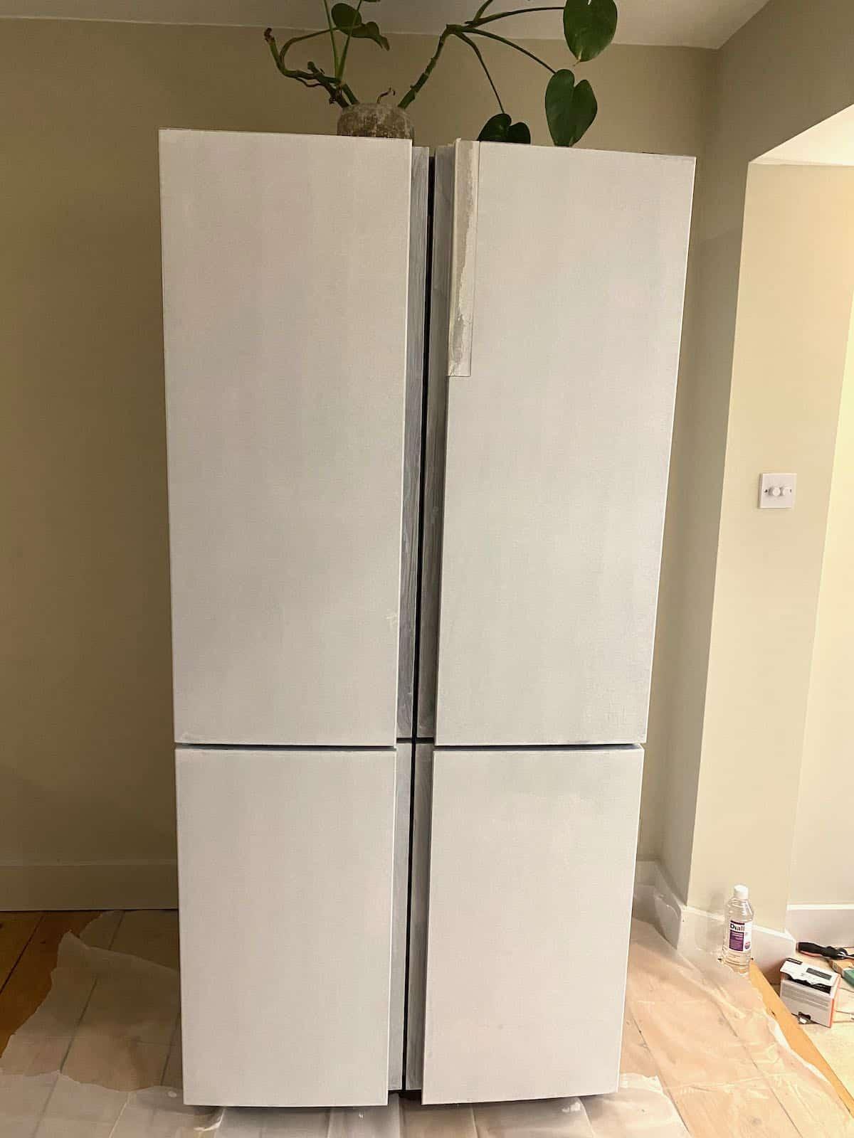 Multi-door fridge freezer painted with primer
