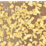 Dried garlic flakes on a flat surface