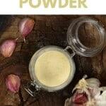 Garlic Powder in a jar with some garlic cloves around it