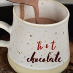 Pouring hot chocolate in a mug