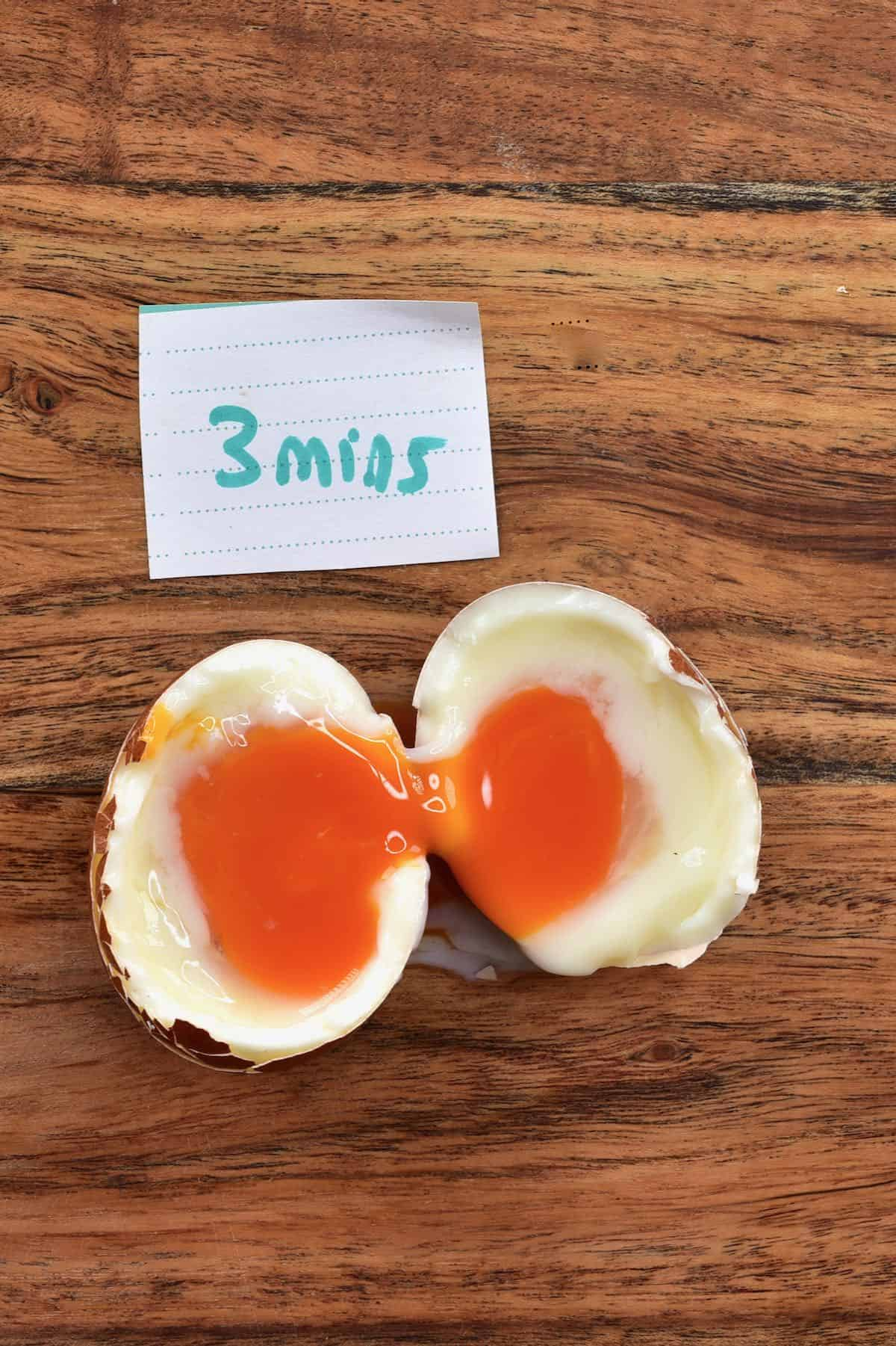Egg boiled for 3 minutes cut in two
