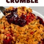 A close up of a spoonful of berry crumble