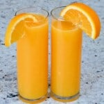 Two glasses with orange juice