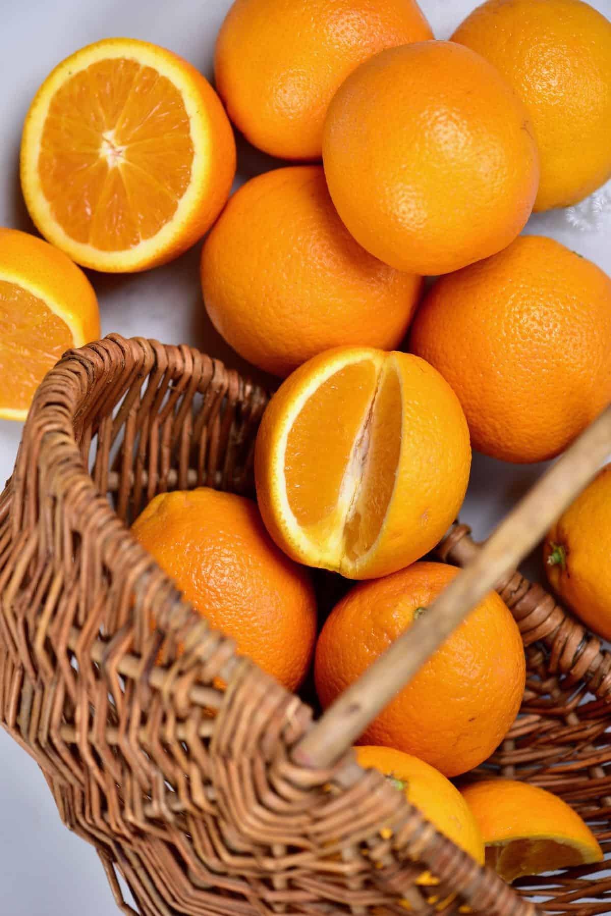 Oranges spilling out of a wooden basket