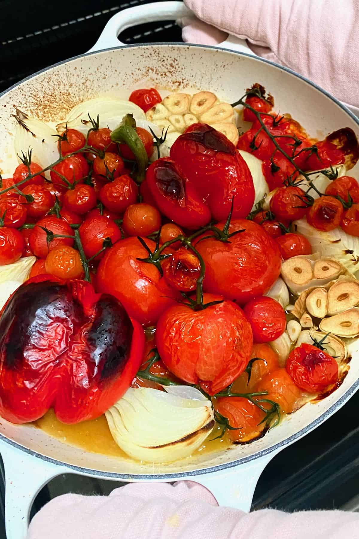 Toasted tomatoes and peppers in a large pan