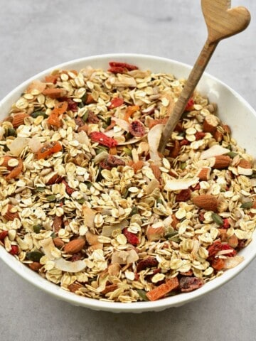 Homemade muesli in a bowl with a wooden spoon