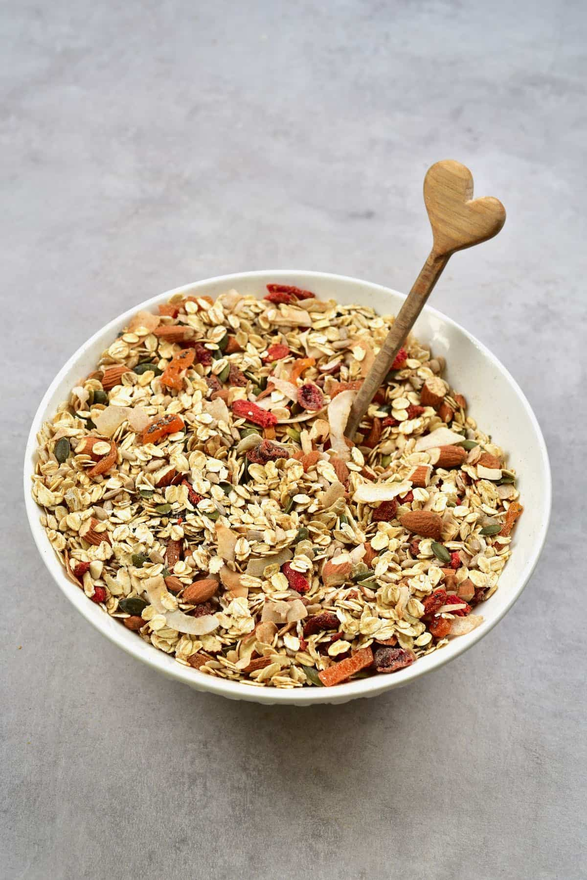 Homemade muesli in a bowl and a wooden spoon