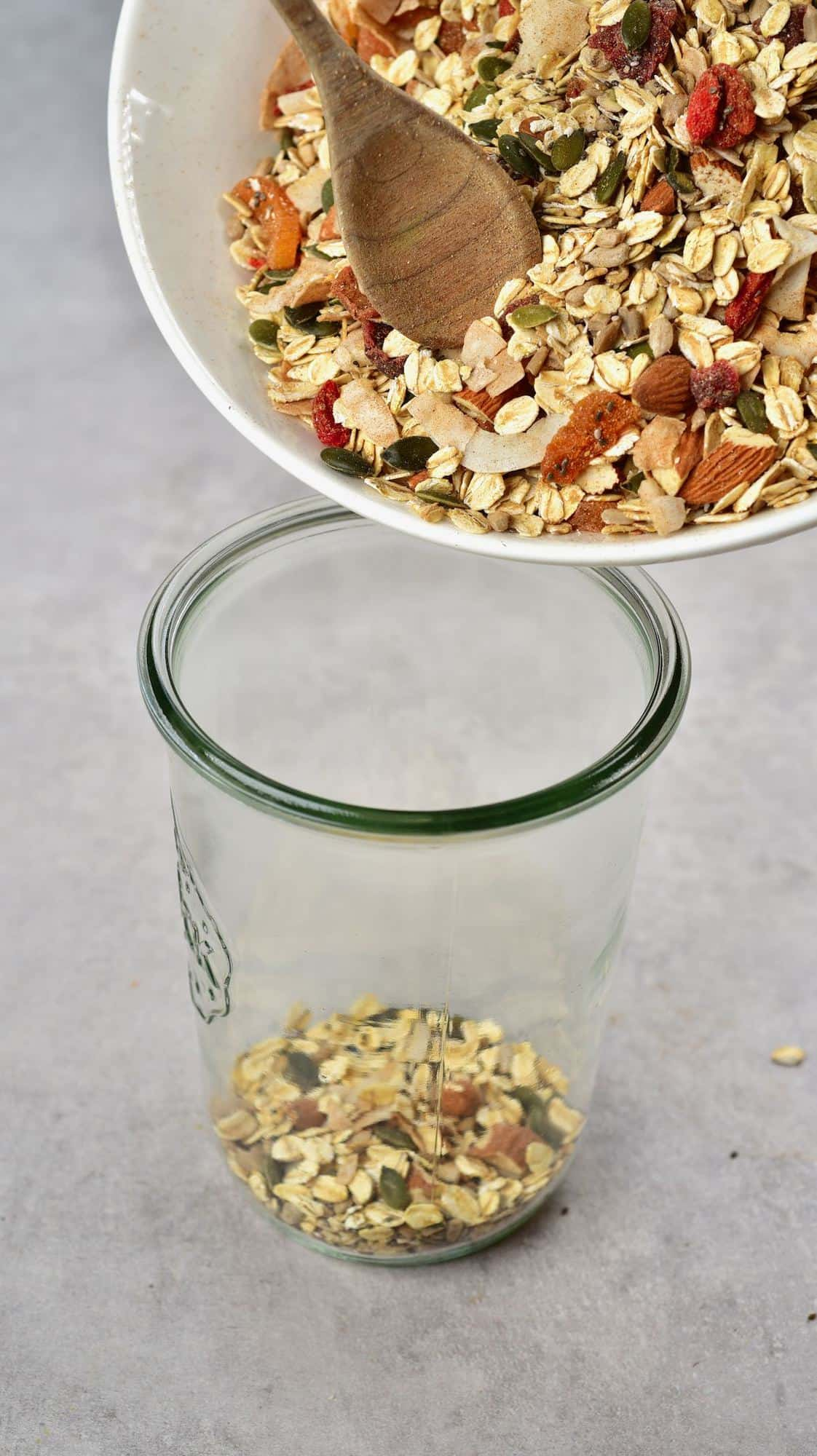 Filling up a jar with homemade muesli