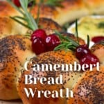Dinner rolls topped with cranberries and baked camembert