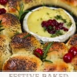 Baked camembert in the center of dinner rolls topped with cranberries