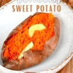 Baked sweet potato topped with butter