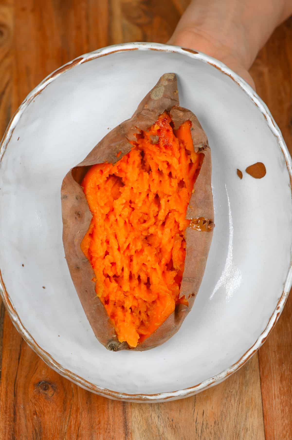 Baked sweet potatoes opened to show the inside