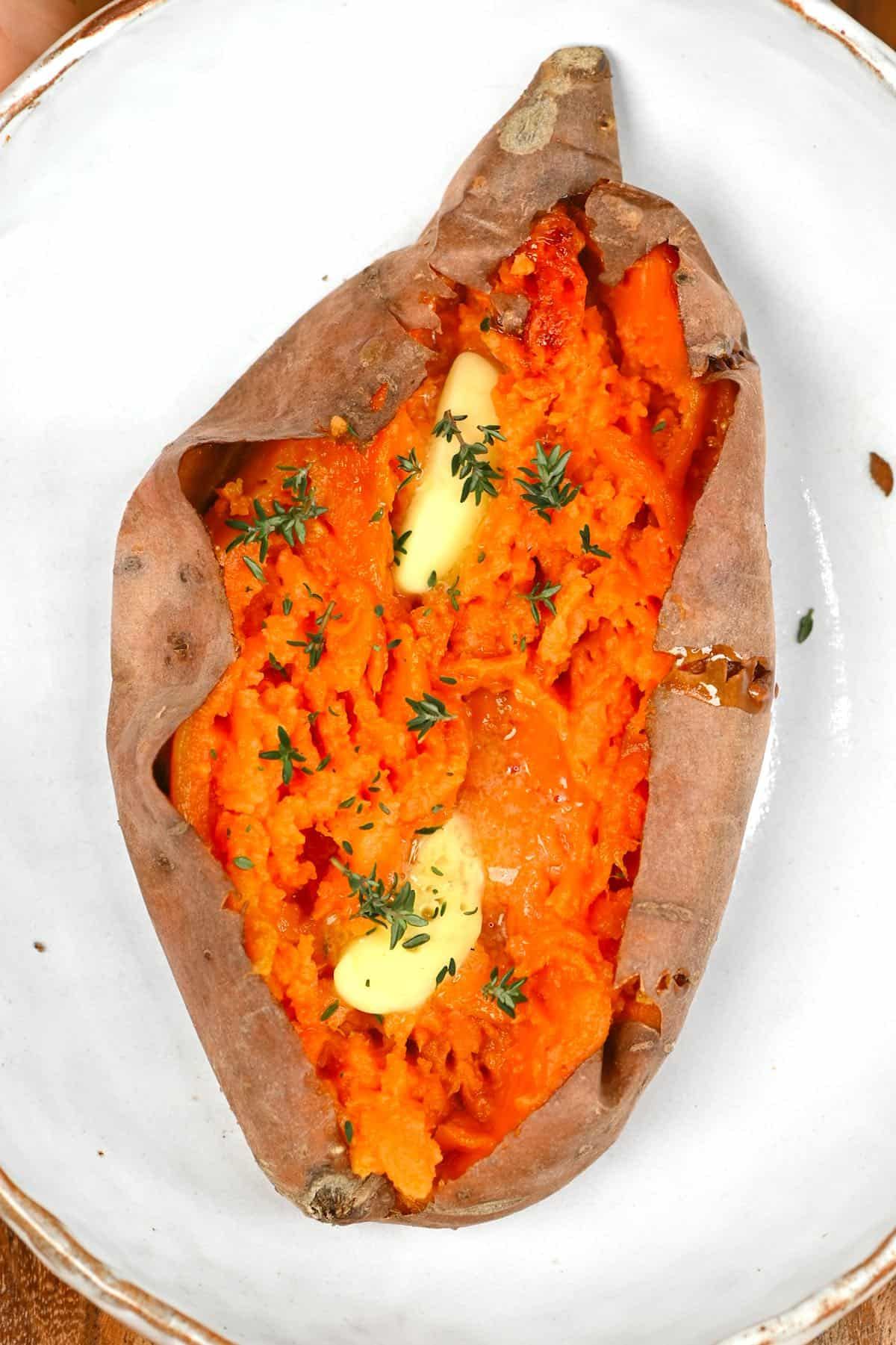 Baked sweet potato with some butter and thyme