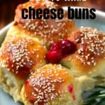 Four buns with cranberries and rosemary