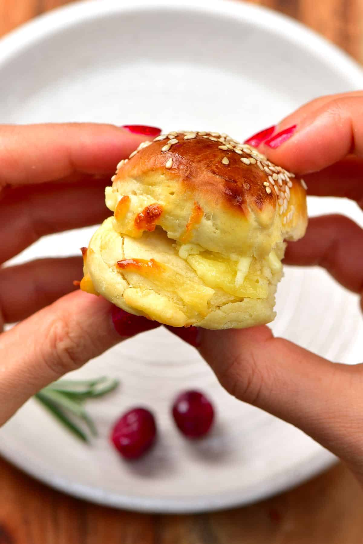 Close up of a cheese bun held by hands