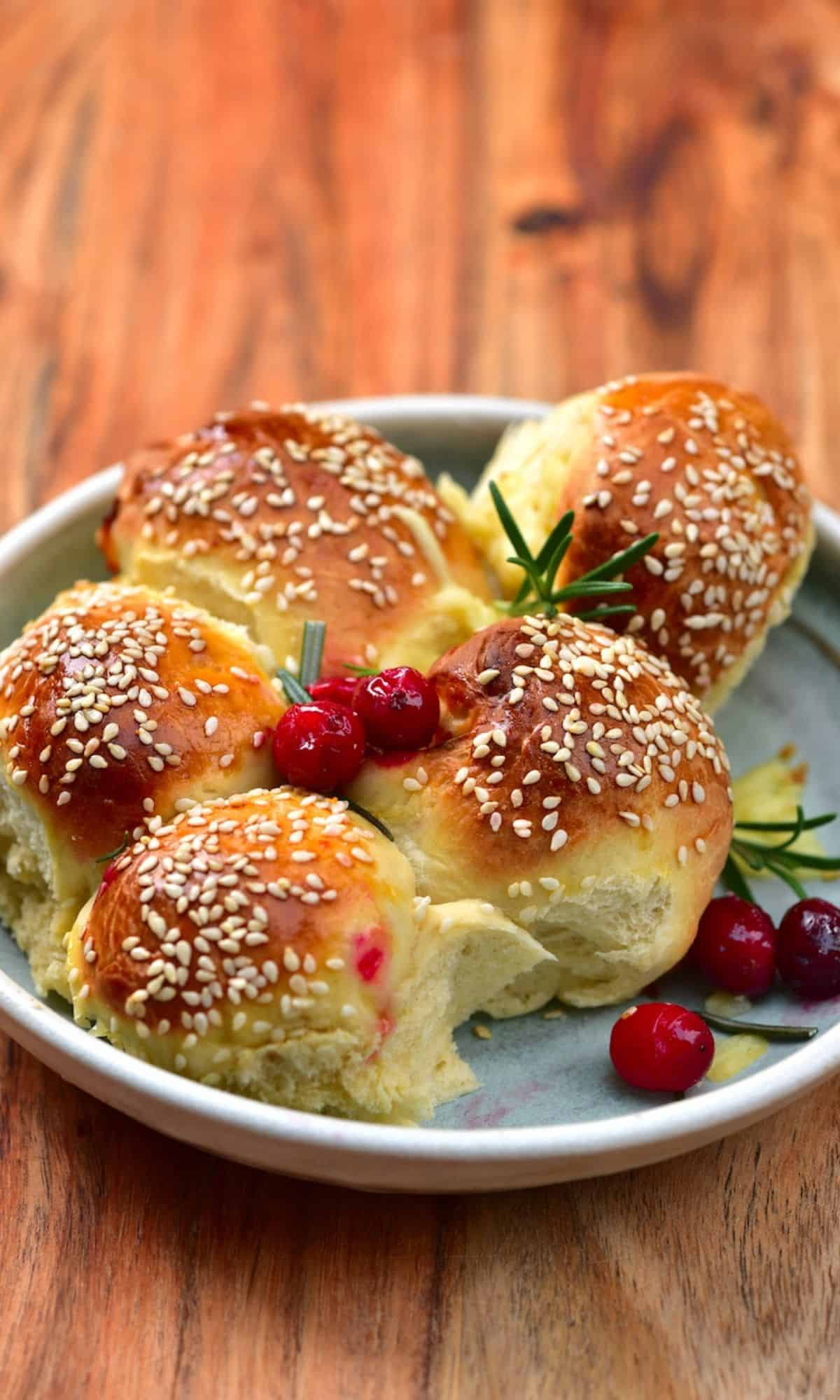 Cheese buns topped with rosemary and cranberries
