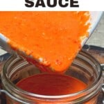 Pouring freshly made chili sauce into a jar