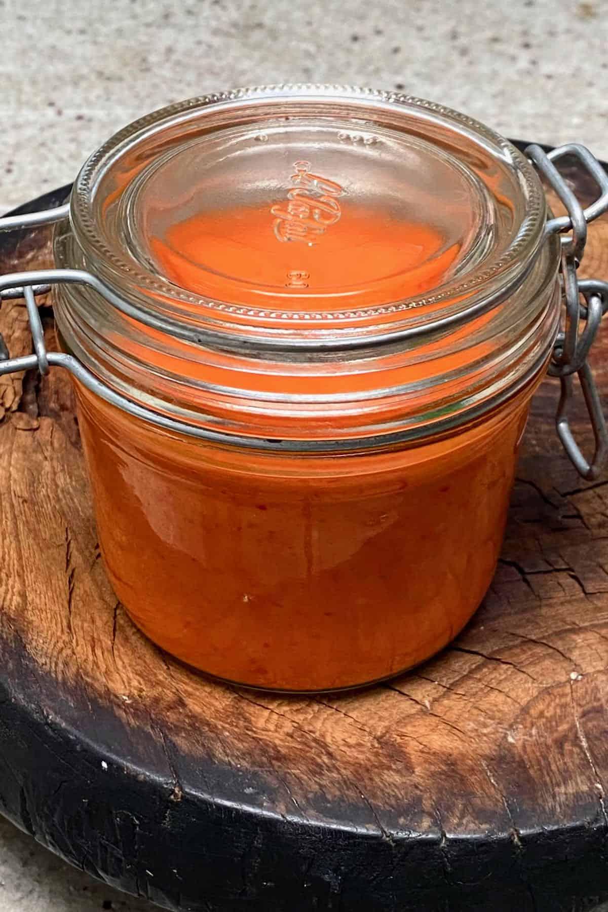 A jar with homemade chili sauce