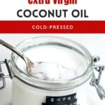 A jar with homemade coconut oil and a spoon dipping int to