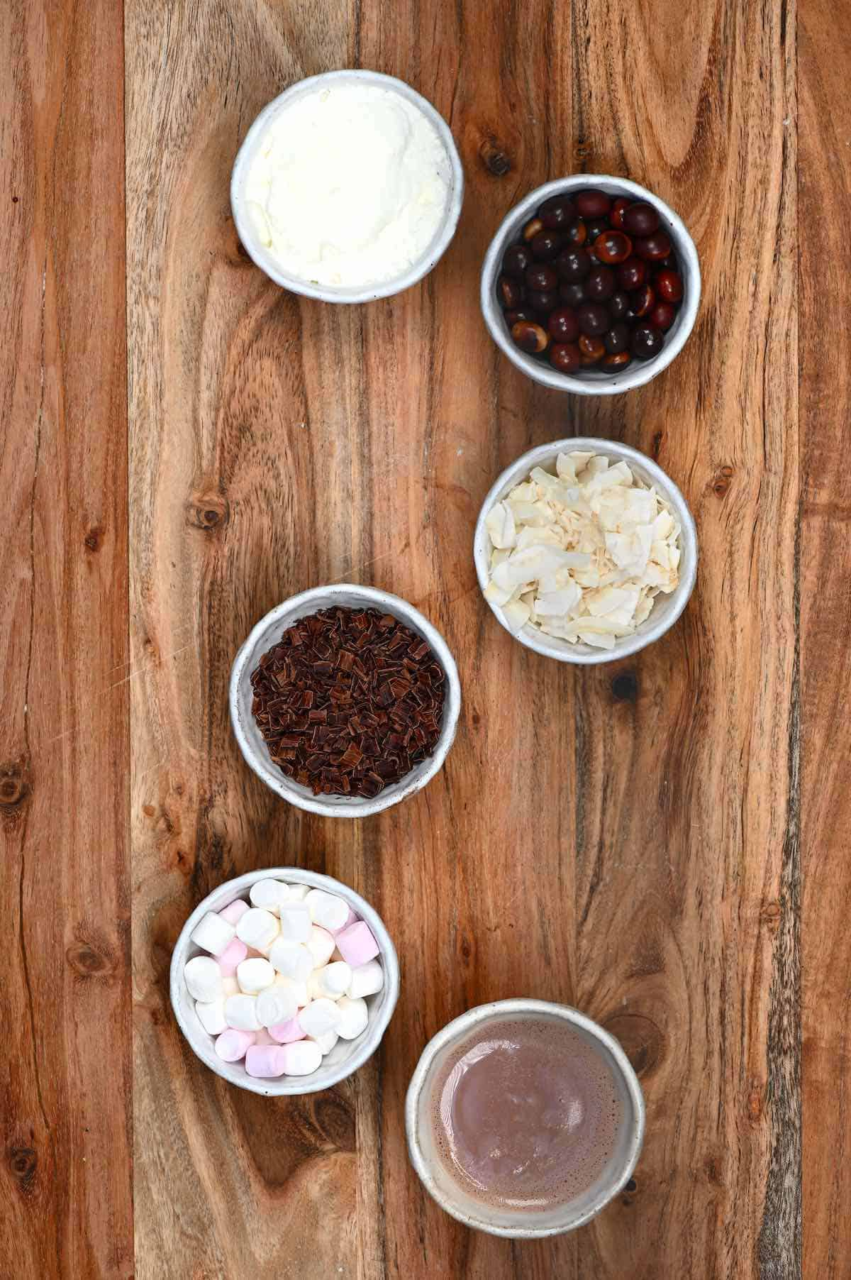 Different toppings for hot chocolate placed in small bowls