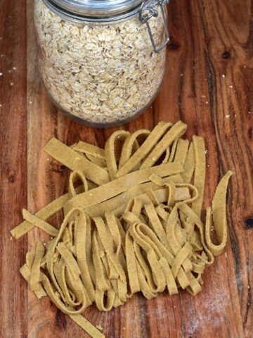 Oat pasta cut as tagliatelle and a jar of oats