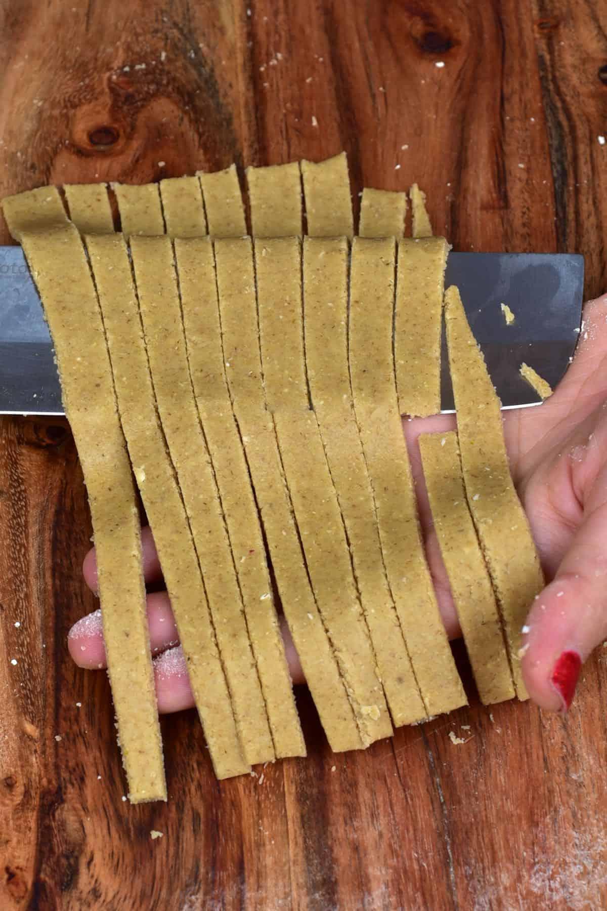 Sliced oat pasta resting on a knife