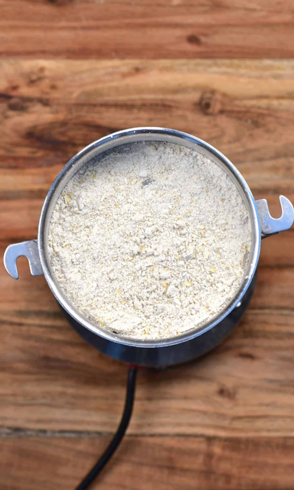 Oat flour in a grinder