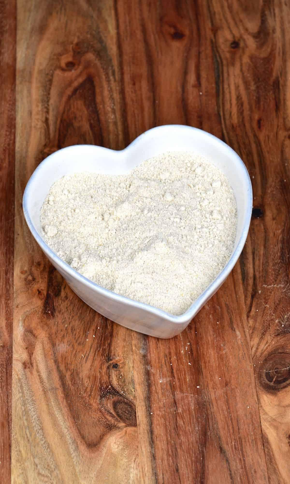 Oat flour in a heart shaped bowl