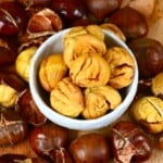 Peeled roasted chestnuts in a small bowl