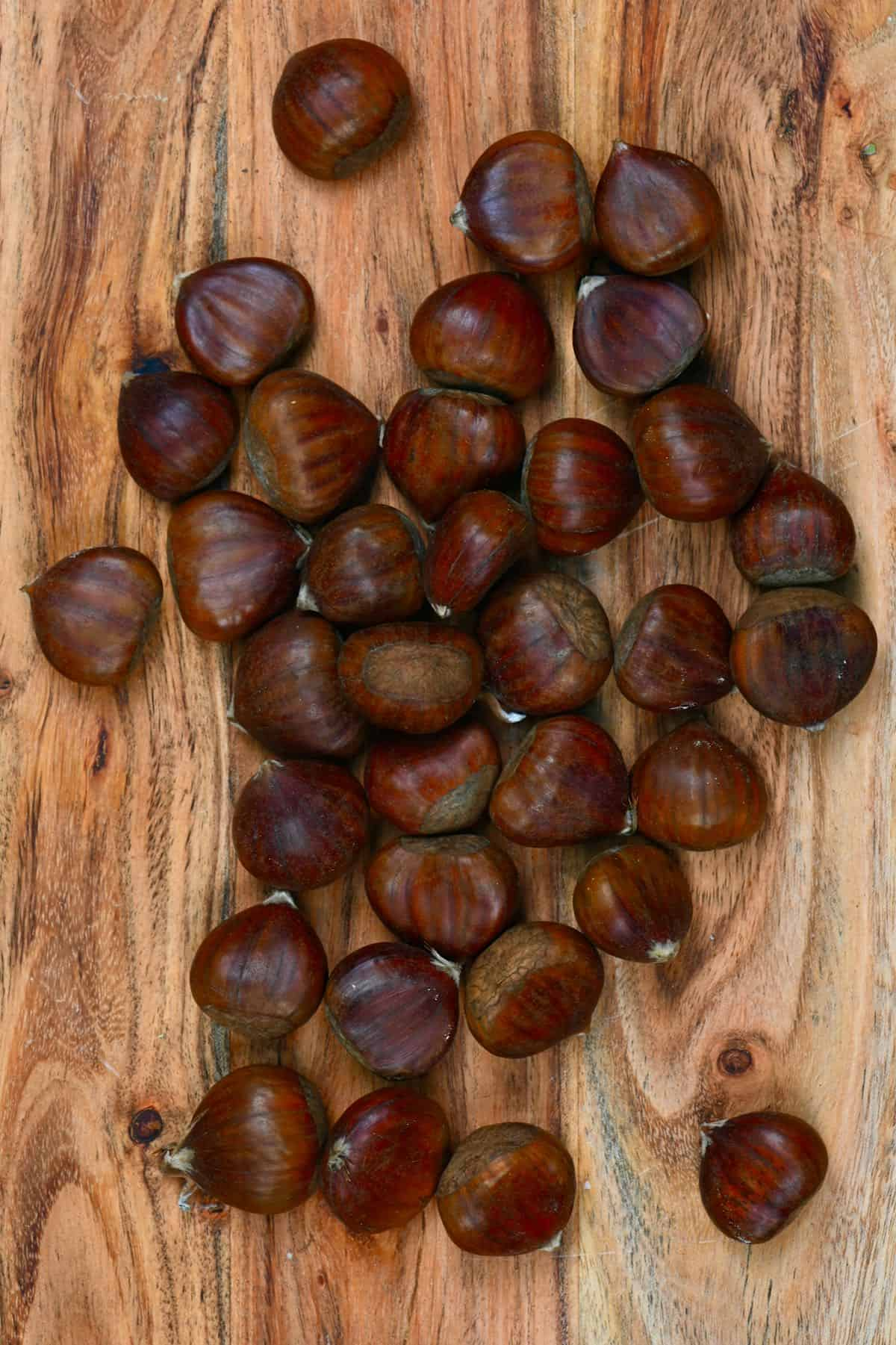 Chestnuts on a wooden board