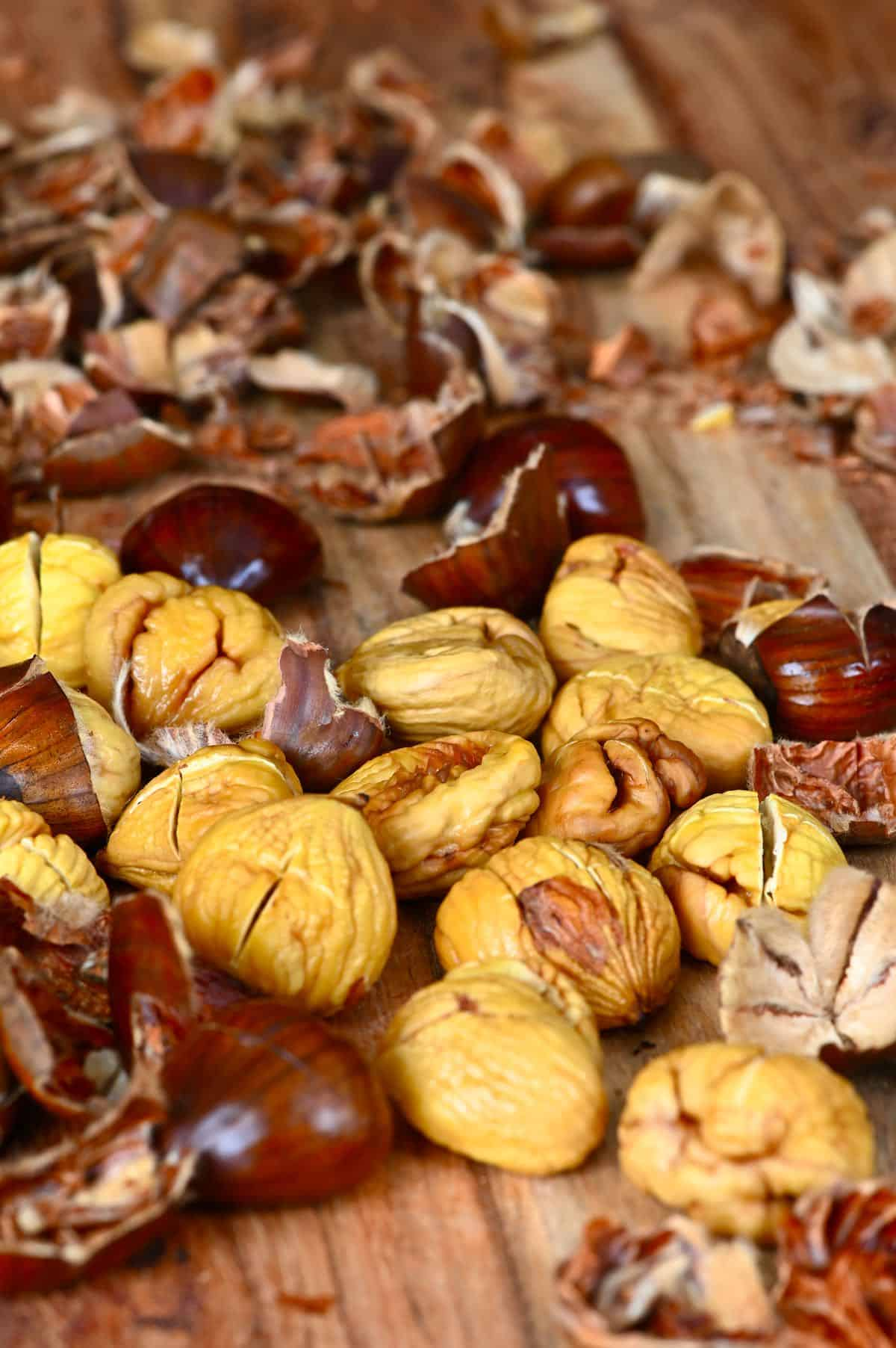 Peeled roasted chestnuts on a wooden board