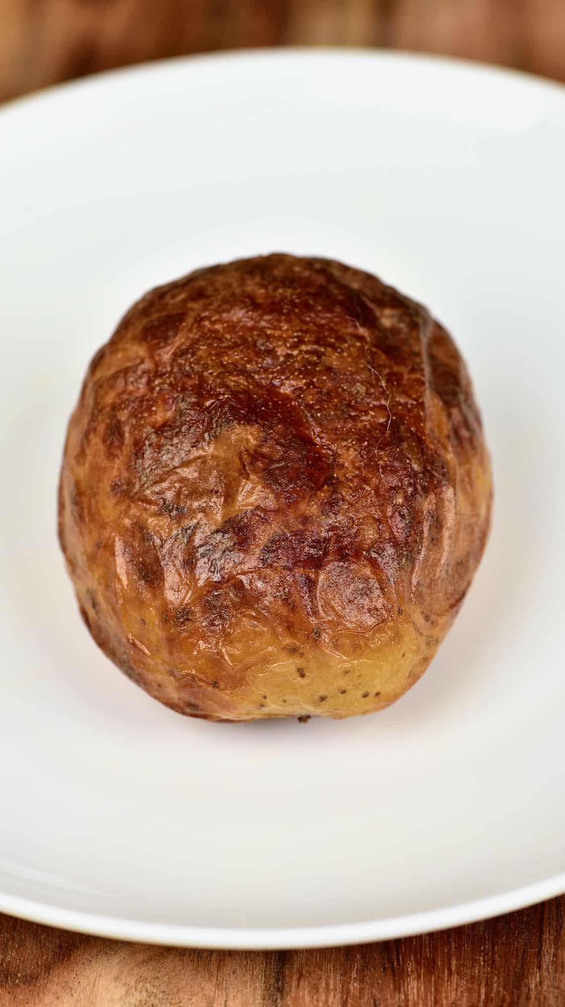 Salt baked potato in a plate