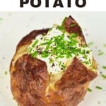 A salt baked potato with cream and herbs toppings