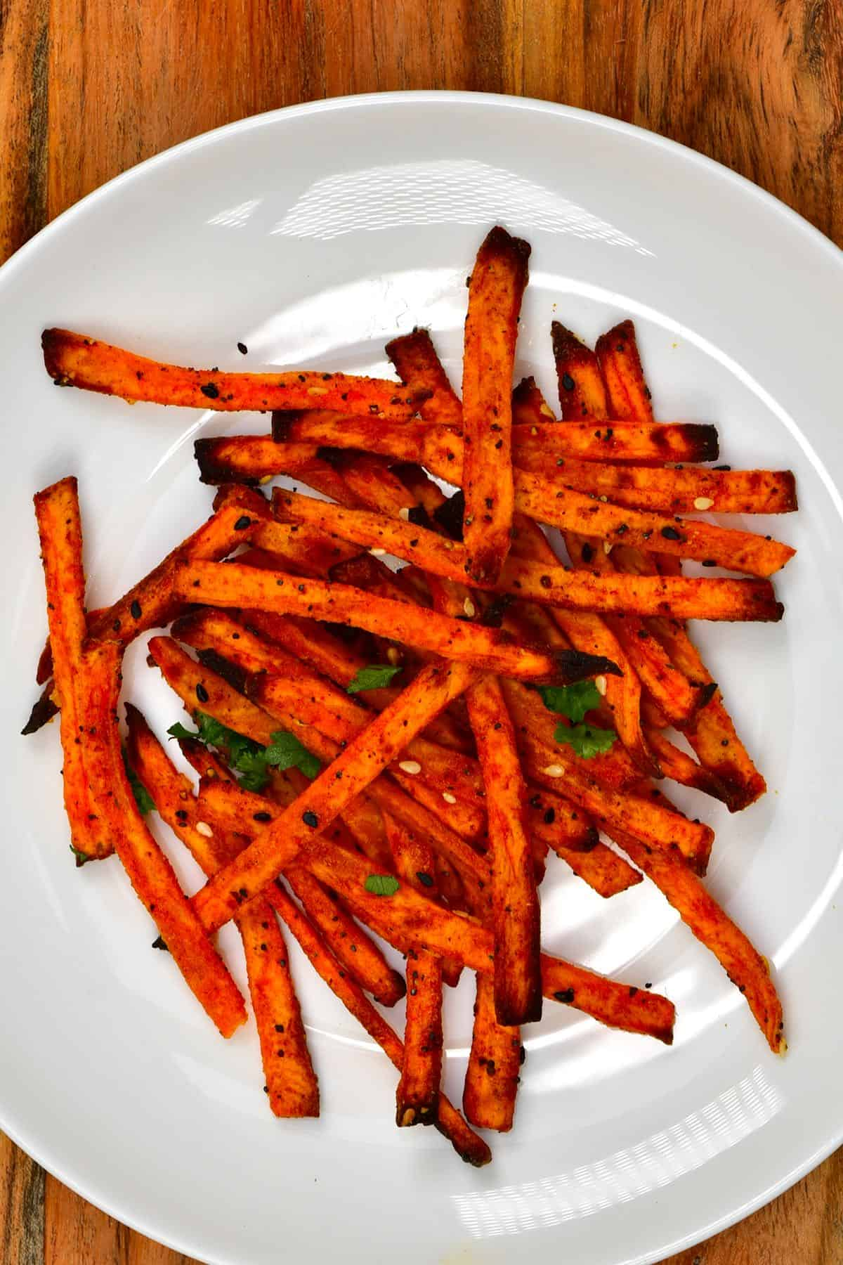 Sweet potato fries in a white plate