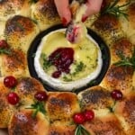 Bun wreath with camembert center topped with cranberries and rosemary
