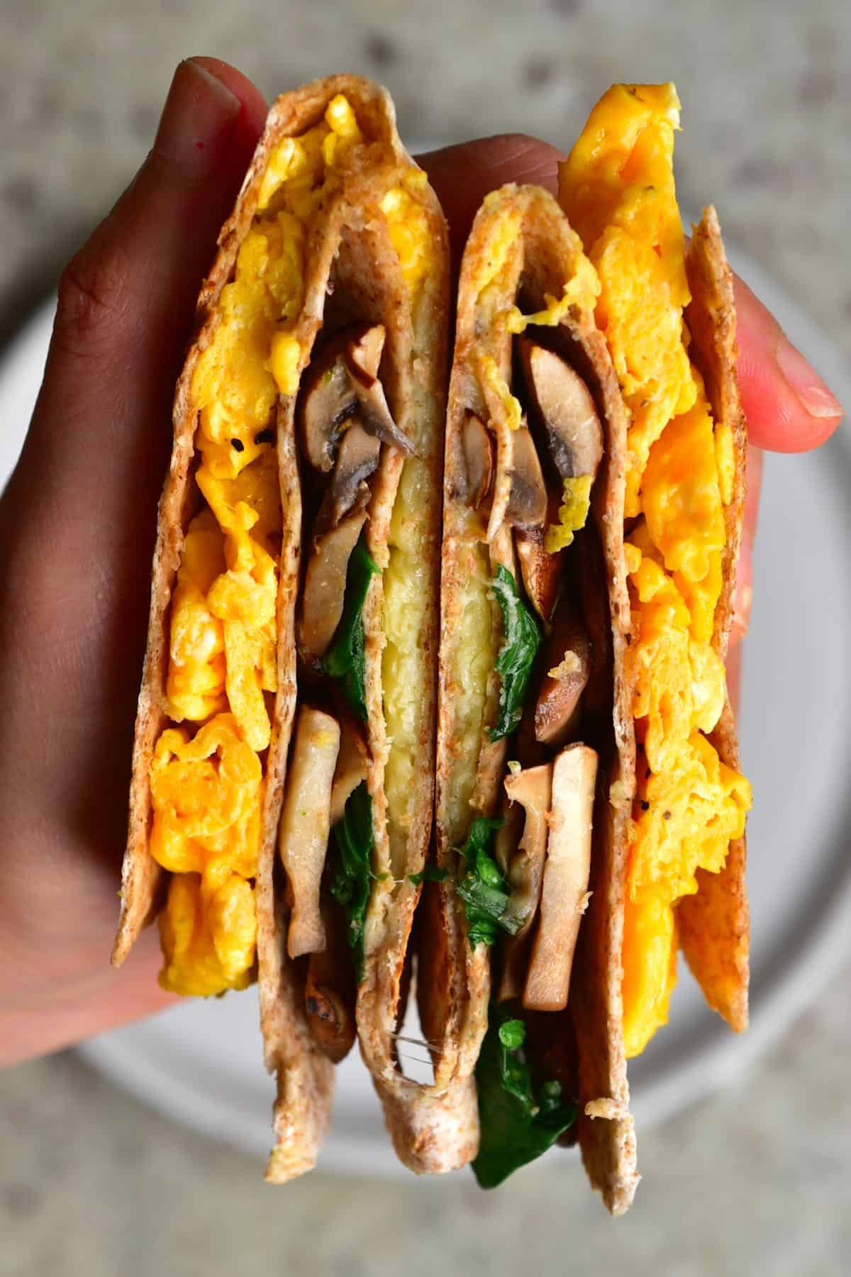 Folded tortilla with mushrooms and scrambled eggs