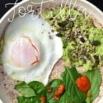 Breakfast tortilla with fired egg, mashed avocado, spinach and omega seeds