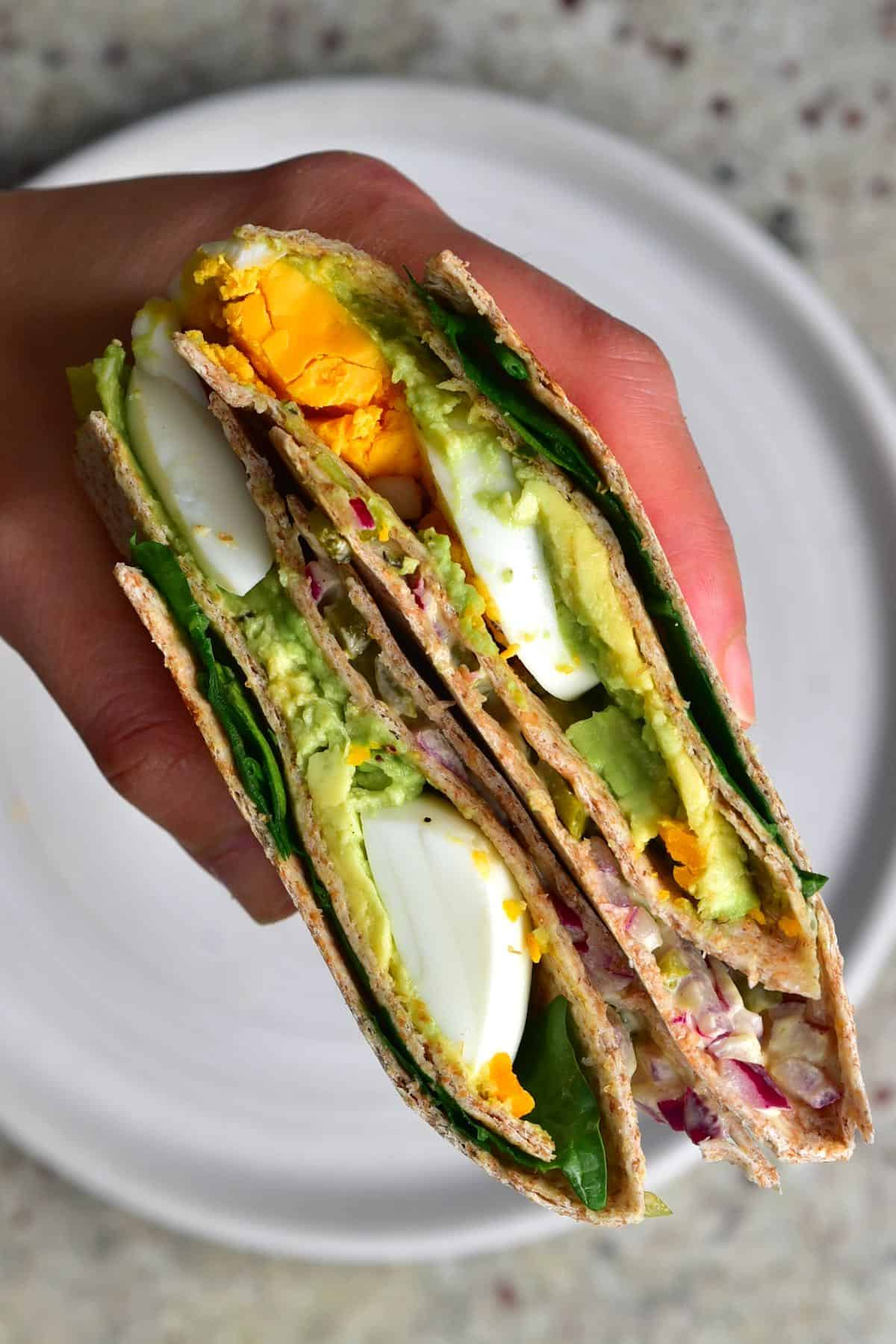 Folded tortilla with add and avocado