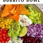 A veggie burrito bowl with tortilla chips