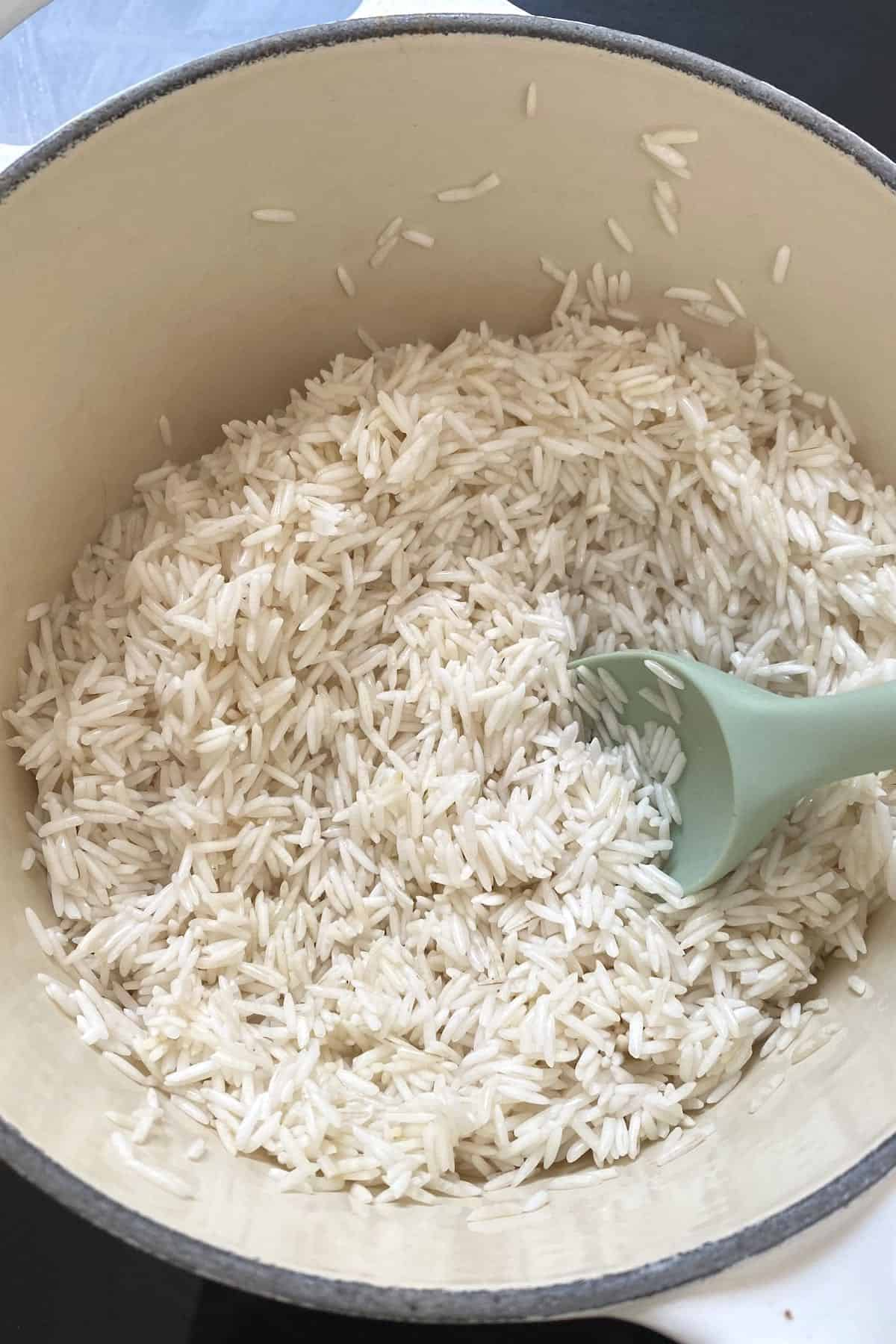 Basmati rice in a pot with a big spoon