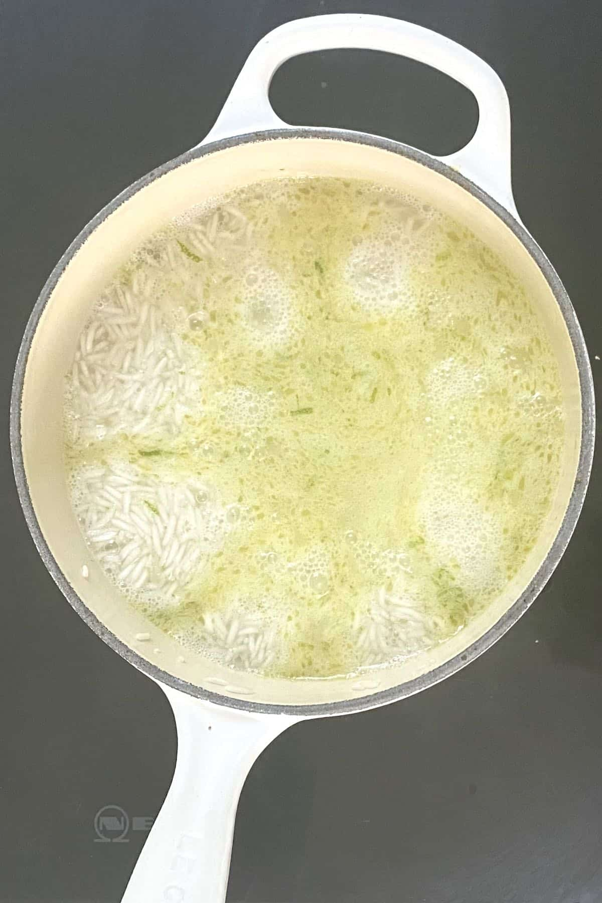 Basmati rice cooking in a pot with water